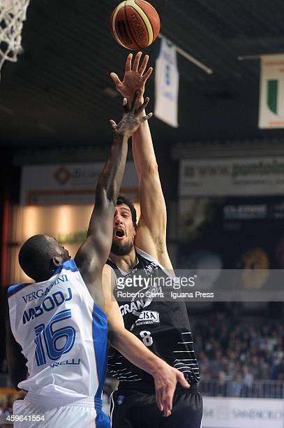 Gino Cuccarolo of Granarolo competes with Cheikh Mbodj of Acqua Vitasnella looks over during the LegaBasket Serie A1 match between Acqua Vitasnella...