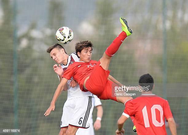 Gino Fechner of Germany challenges Cengiz Uender of Turkey during the international friendly match between U18 Germany and U18 Turkey on November 17...