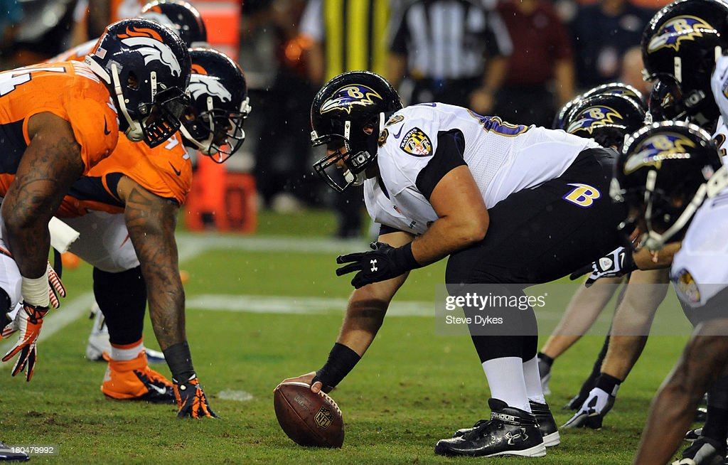 <a gi-track='captionPersonalityLinkClicked' href=/galleries/search?phrase=Gino+Gradkowski&family=editorial&specificpeople=4640006 ng-click='$event.stopPropagation()'>Gino Gradkowski</a> #66 of the Baltimore Ravens gets set to snap the ball during the first quarter of the game against the Denver Broncos at Sports Authority Field at Mile High on September 5, 2013 in Denver, Colorado.