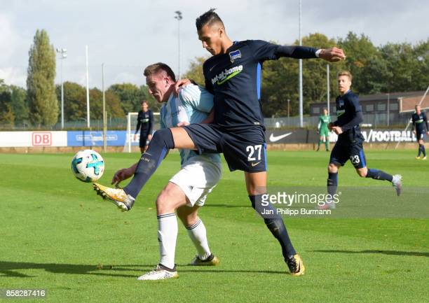Gino Krumnow of the police epresentative team and Davie Selke of Hertha BSC during the test match between Hertha BSC and the police epresentative...