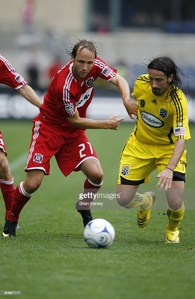 Gino Padula of the Columbus Crew and Justin Mapp of the Chicago Fire go for the bal during the second half at Toyota Park on September 20 2009 in...