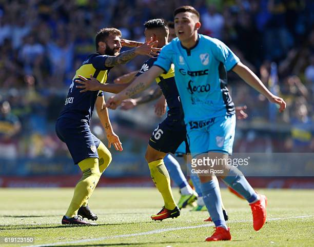 Gino Peruzzi of Boca Juniors and celebrates with teammate Adrian Centurion after scoring the first goal of his team during a match between Boca...