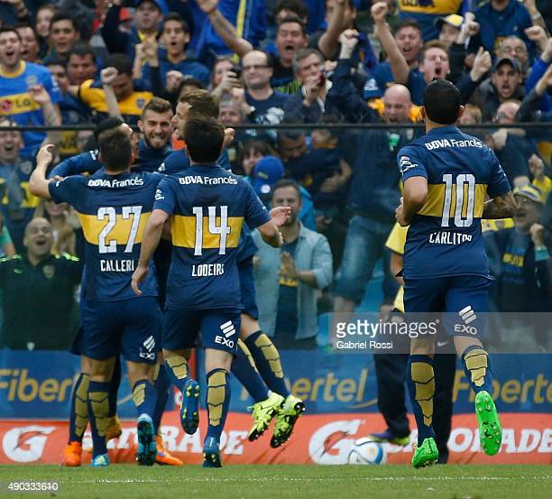 Gino Peruzzi of Boca Juniors celebrates with his teammates after scoring the first goal of his team during a match between Boca Juniors and Banfield...