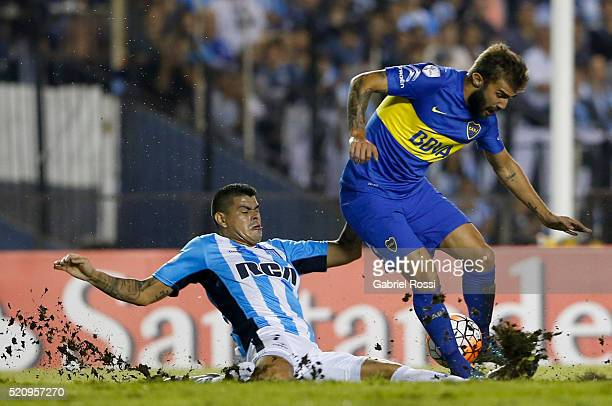 Gino Peruzzi of Boca Juniors fights for the ball with Gustavo Bou of Racing Club during a match between Racing and Boca Juniors as part of Copa...