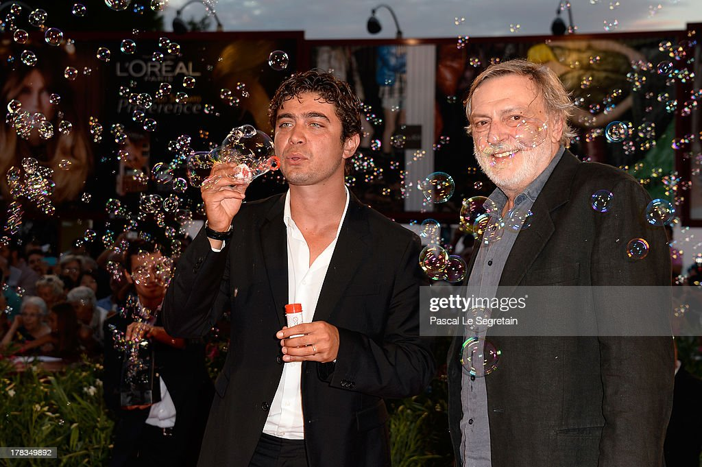 <a gi-track='captionPersonalityLinkClicked' href=/galleries/search?phrase=Gino+Strada&family=editorial&specificpeople=4203022 ng-click='$event.stopPropagation()'>Gino Strada</a> and <a gi-track='captionPersonalityLinkClicked' href=/galleries/search?phrase=Riccardo+Scamarcio&family=editorial&specificpeople=816804 ng-click='$event.stopPropagation()'>Riccardo Scamarcio</a> attend the 'Tracks' premiere during the 70th Venice International Film Festival at the Palazzo del Cinema on August 29, 2013 in Venice, Italy.