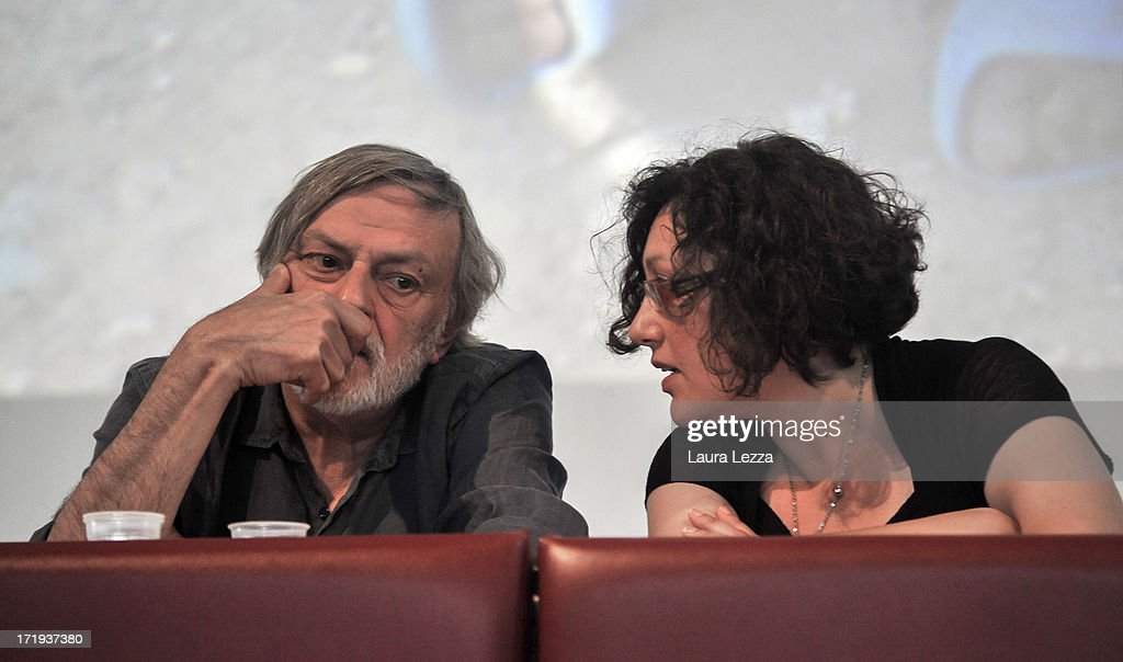 <a gi-track='captionPersonalityLinkClicked' href=/galleries/search?phrase=Gino+Strada&family=editorial&specificpeople=4203022 ng-click='$event.stopPropagation()'>Gino Strada</a> (L), founder of Emergency, and Rossella Miccio, Coordinator of the Humanitarian Office of Emergency, attend the Emergency National Meeting on June 29, 2013 in Livorno, Italy. Italian independent organisation 'Emergency', which also have a branch in North America, transport doctors and medical equipment to regions suffering from poverty and conflict to provide free treatment to those who need it. Volunteers, supporters and politicians met today to discuss the charity's work with the theme of 'Rights and Privileges'.