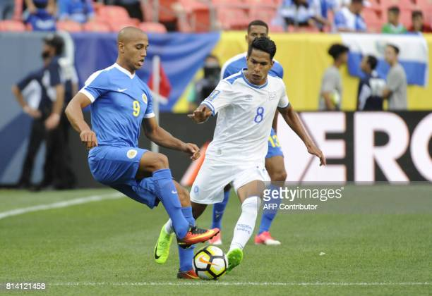 Gino van Kessel of Curacao and Denis Pineda of El Salvador vie for control of the ball during the El Salvador vs Curacao CONCACAF Group C Gold Cup...