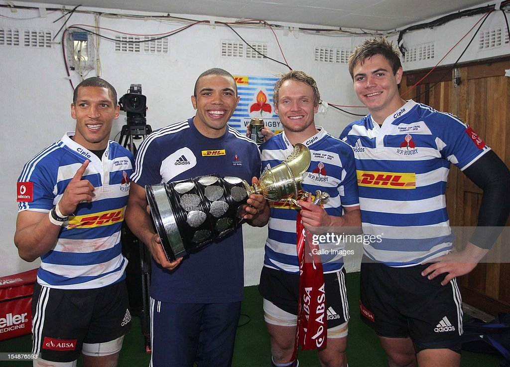 Gio Aplon, Bryan Habana, Joe Pietersen and Gerhard van den Heever of Western Province celebrates with the trophy after the Absa Currie Cup final match between The Sharks and DHL Western Province from Mr Price KINGS PARK on October 27, 2012 in Durban, South Africa.