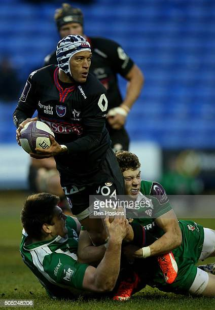Gio Aplon of Grenoble is tackled by Theo Brophy Clews of London Irish during the European Rugby Challenge Cup match between London Irish and Grenoble...