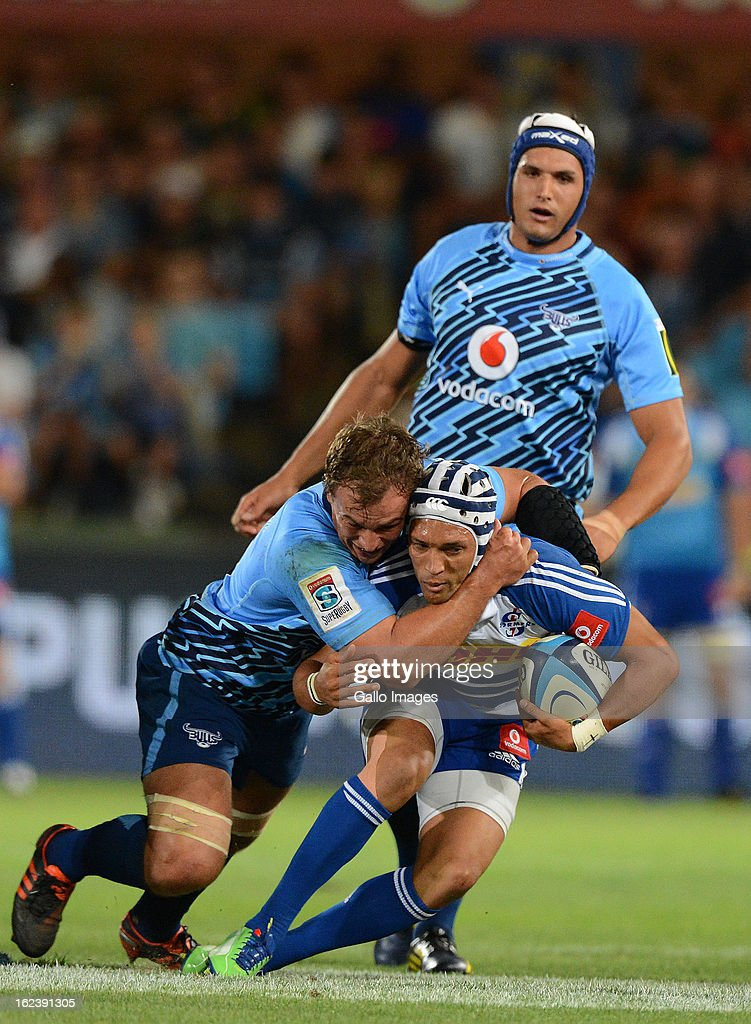 Gio Aplon of the Stormers gets tackled during the Super Rugby match between Vodacom Bulls and DHL Stormers from Loftus Versfeld Stadium on February 22, 2013 in Pretoria, South Africa.