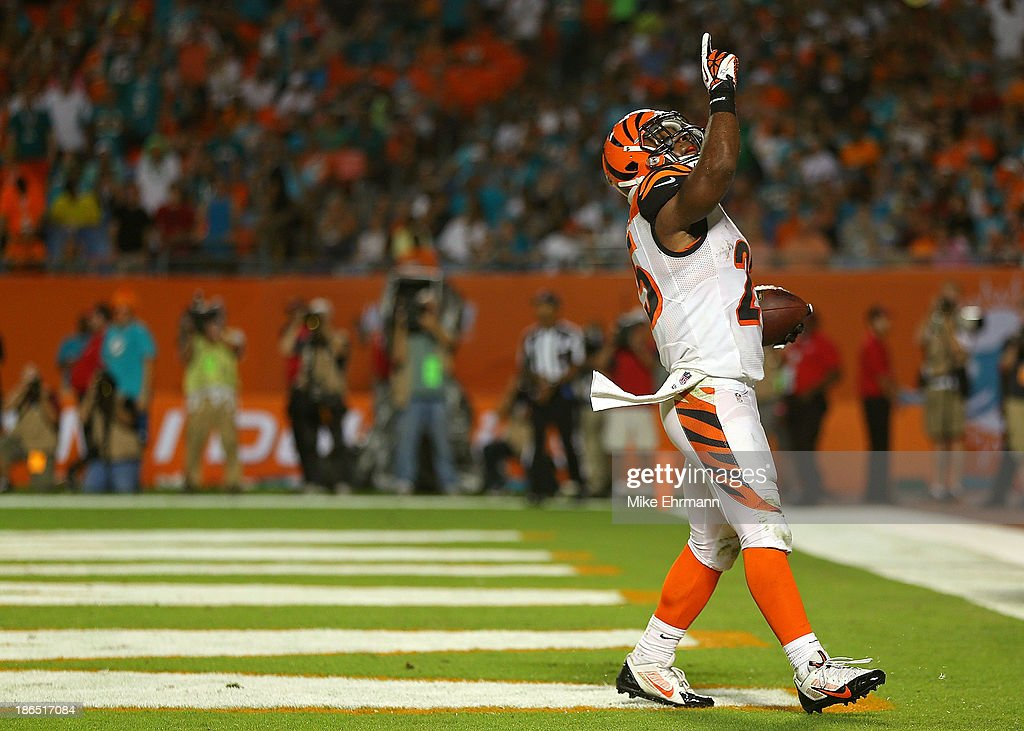 Gio Bernard #25 of the Cincinnati Bengals reacts to a touchdown during a game against the Miami Dolphins at Sun Life Stadium on October 31, 2013 in Miami Gardens, Florida.