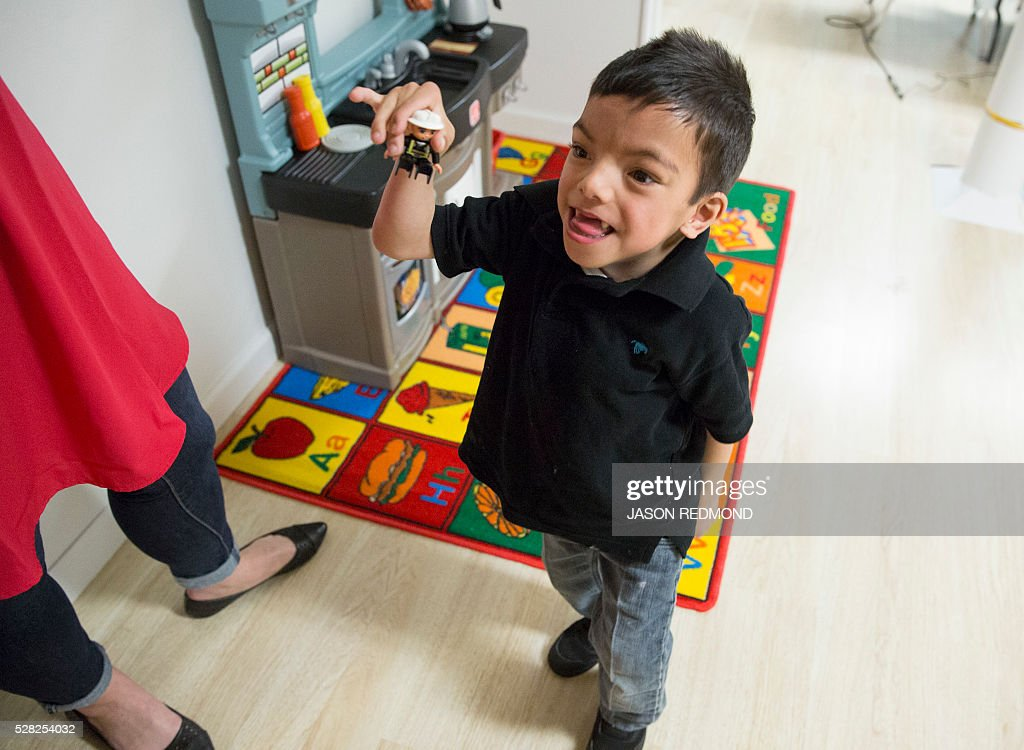 Gio Caro, 6, is pictured inside a playroom in a building that Amazon owns and is allowing the non profit to use as a temporary shelter for women and their families in Seattle, Washington on May 4, 2016. According to the non profit, Marys Place is a temporary emergency family nightshelter housing up to 60 families each night, including pets. Mary's place helps homeless women, children and families to reclaim their lives by providing shelter, nourishment, resources, healing and hope in a safe community. / AFP / Jason Redmond