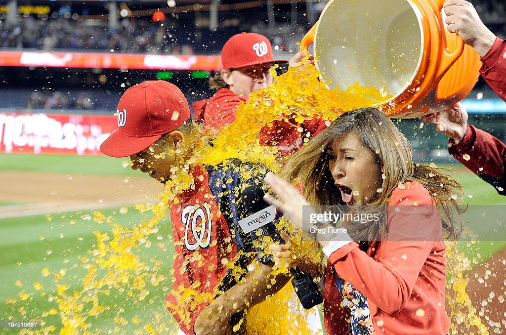 <a gi-track='captionPersonalityLinkClicked' href=/galleries/search?phrase=Gio+Gonzalez&family=editorial&specificpeople=759378 ng-click='$event.stopPropagation()'>Gio Gonzalez</a> #47 of the Washington Nationals and announcer Julie Alexandria get a gatorade bath after a 8-1 victory against the Cincinnati Reds at Nationals Park on April 25, 2013 in Washington, DC.