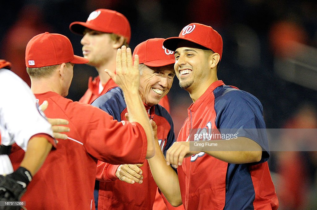 <a gi-track='captionPersonalityLinkClicked' href=/galleries/search?phrase=Gio+Gonzalez&family=editorial&specificpeople=759378 ng-click='$event.stopPropagation()'>Gio Gonzalez</a> #47 of the Washington Nationals celebrates with manager <a gi-track='captionPersonalityLinkClicked' href=/galleries/search?phrase=Davey+Johnson+-+Baseball+Manager&family=editorial&specificpeople=93273 ng-click='$event.stopPropagation()'>Davey Johnson</a> after a 8-1 victory against the Cincinnati Reds at Nationals Park on April 25, 2013 in Washington, DC.
