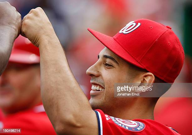 Gio Gonzalez of the Washington Nationals fistbumps with teammates in the dugout before his start against the New York Mets at Nationals Park on...