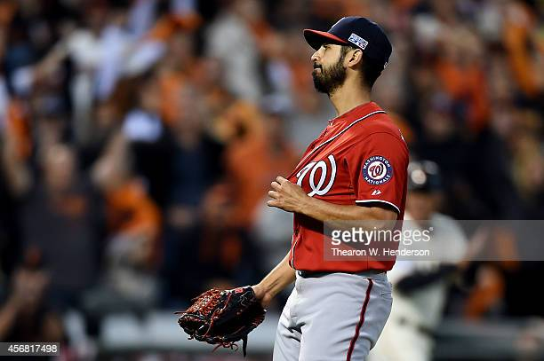 Gio Gonzalez of the Washington Nationals reacts after he walked Gregor Blanco scoring Brandon Crawford of the San Francisco Giants in the second...