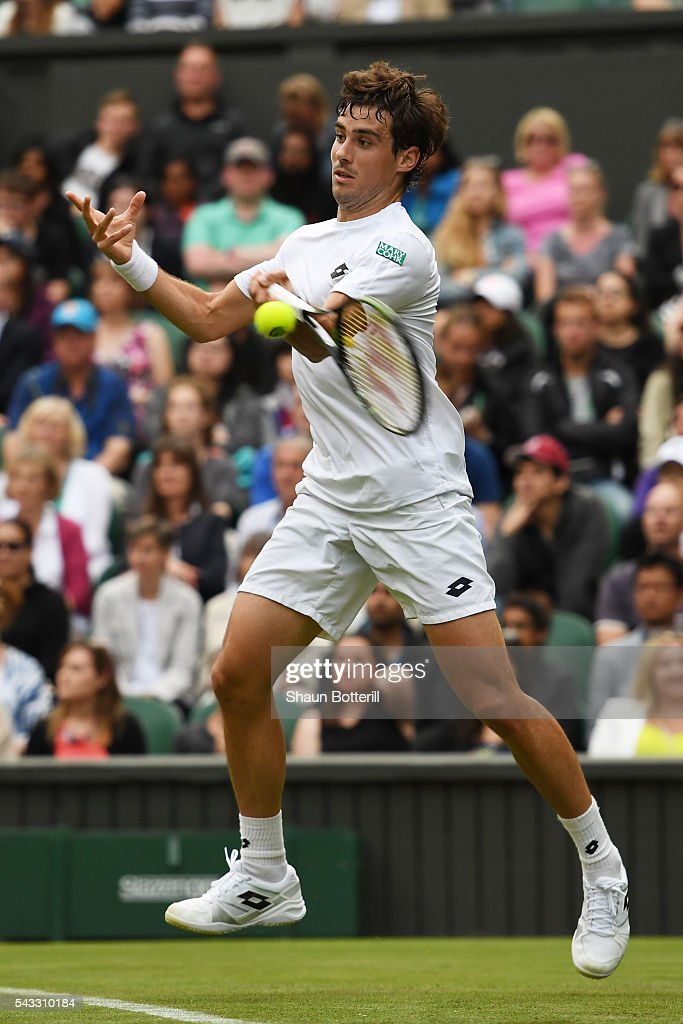 Giodo Pella of Argentina plays a forehand shot during the Men's Singles first round match against Roger Federer of Switzerland on day one of the Wimbledon Lawn Tennis Championships at the All England Lawn Tennis and Croquet Club on June 27th, 2016 in London, England.