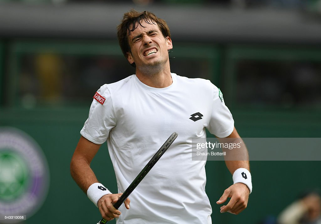 Giodo Pella of Argentina reacts during the Men's Singles first round match against Roger Federer of Switzerland on day one of the Wimbledon Lawn Tennis Championships at the All England Lawn Tennis and Croquet Club on June 27th, 2016 in London, England.