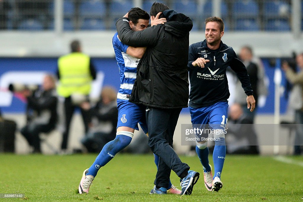 Giorgi Chanturia and head coach Ilia Gruev of Duisburg celebrate the opening goal during the 2. Bundesliga playoff leg 2 match between MSV Duisburg and Wuerzburger Kickers at Schauinsland-Reisen-Arena on May 24, 2016 in Duisburg, Germany.