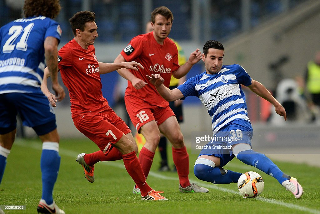 Giorgi Chanturia (R) of Duisburg battles for the ball during the 2. Bundesliga playoff leg 2 match between MSV Duisburg and Wuerzburger Kickers at Schauinsland-Reisen-Arena on May 24, 2016 in Duisburg, Germany.