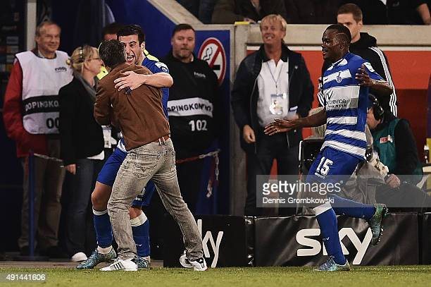 Giorgi Chanturia of MSV Duisburg celebrates with team mates and head coach Gino Lettieri as he scores the opening goal during the Second Bundesliga...