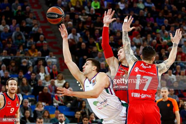 Giorgi Shermadini #17 of Unicaja Malaga competes with during the 2017/2018 Turkish Airlines EuroLeague Regular Season Round 11 game between Baskonia...