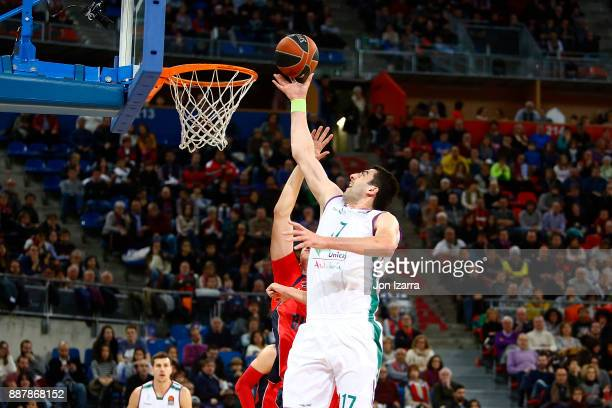 Giorgi Shermadini #17 of Unicaja Malaga in action during the 2017/2018 Turkish Airlines EuroLeague Regular Season Round 11 game between Baskonia...