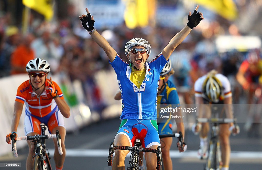 <a gi-track='captionPersonalityLinkClicked' href=/galleries/search?phrase=Giorgia+Bronzini&family=editorial&specificpeople=2501868 ng-click='$event.stopPropagation()'>Giorgia Bronzini</a> of Italy celebrates as she crosses the finish line to win the Women's Elite Road Race on day four of the UCI Road World Championships on October 2, 2010 in Geelong, Australia.