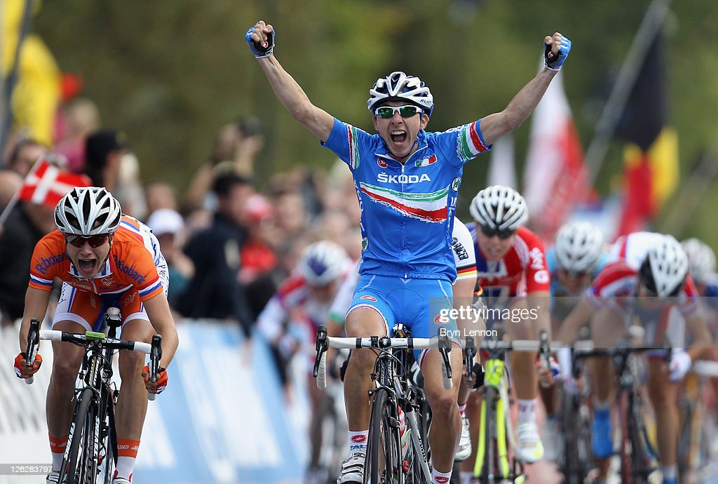 <a gi-track='captionPersonalityLinkClicked' href=/galleries/search?phrase=Giorgia+Bronzini&family=editorial&specificpeople=2501868 ng-click='$event.stopPropagation()'>Giorgia Bronzini</a> of Italy crosses the finish line to win the Elite Women's Road Race during day six of the UCI Road World Championships on September 24, 2011 in Copenhagen, Denmark.