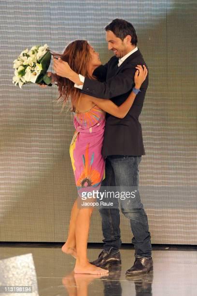 Giorgia Palmas and Davide Bombardini attend 'L'Isola Dei Famosi' The Final on April 26 2011 in Milan Italy