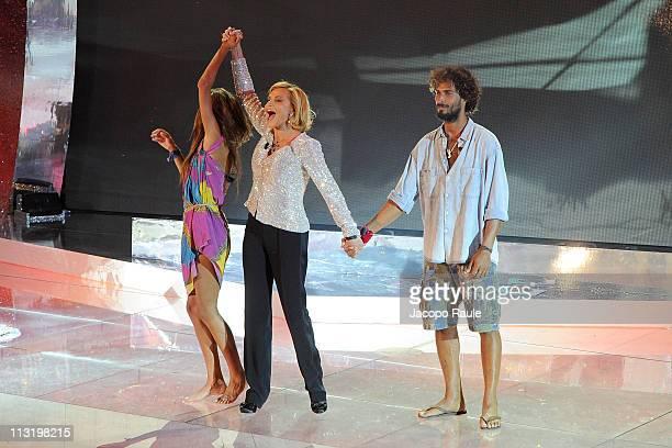 Giorgia Palmas Simona Ventura and Thyago Alves attend 'L'Isola Dei Famosi' The Final on April 26 2011 in Milan Italy