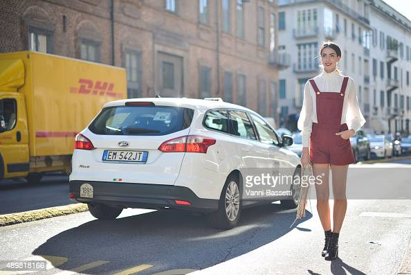 Giorgia Rossetto poses wearing a Lipstick Sisters overall before the Max Mara show during the Milan Fashion Week Spring/Summer 16 on September 24...