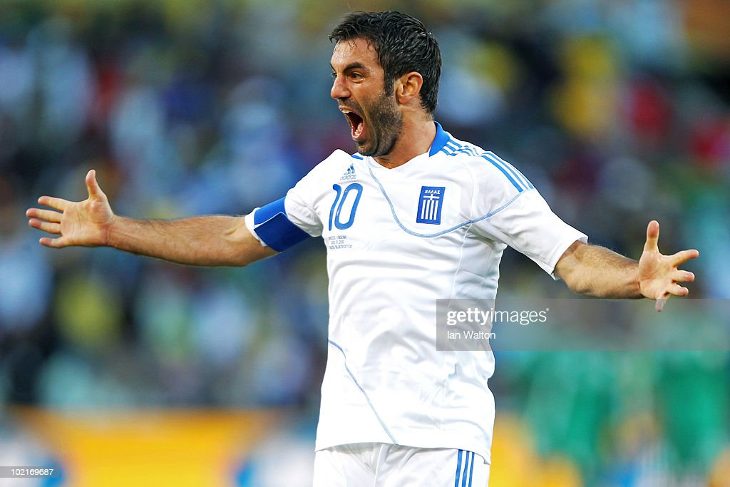 Giorgias Karagounis of Greece celebrates after Dimitrios Salpingidis scores a goal during the 2010 FIFA World Cup South Africa Group B match between Greece and Nigeria at the Free State Stadium on June 17, 2010 in Mangaung/Bloemfontein, South Africa.