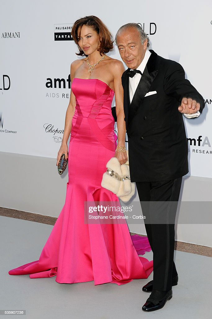 Giorgio Armani and a guest attend the '2010 amfAR's Cinema Against AIDS' Gala