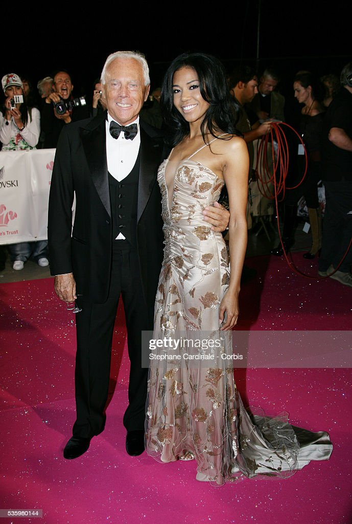 Giorgio Armani and Amerie arrive at the Swarovski Fashion Rocks gala held in Monaco.