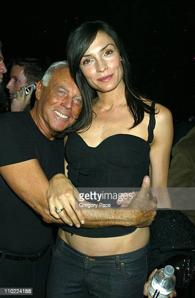 Giorgio Armani and Famke Janssen during Giorgio Armani Spring Summer 2005 Collection After Party at Pier 94 in New York City New York United States