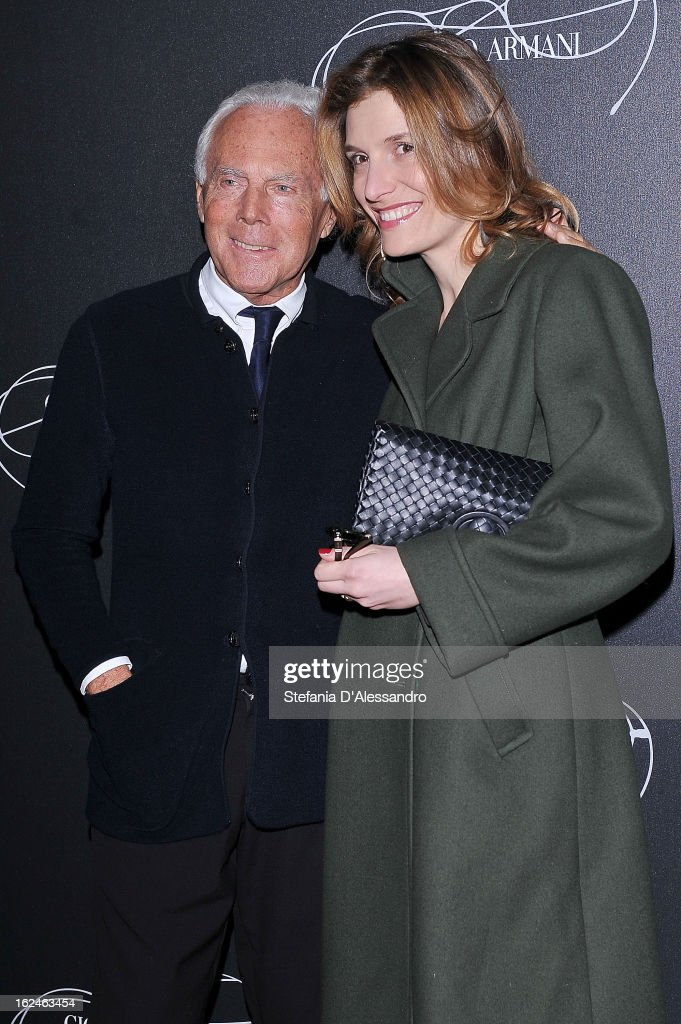 Giorgio Armani and Martina Mondadori attend Giorgio Armani - Luxottica Event on February 23, 2013 in Milan, Italy.