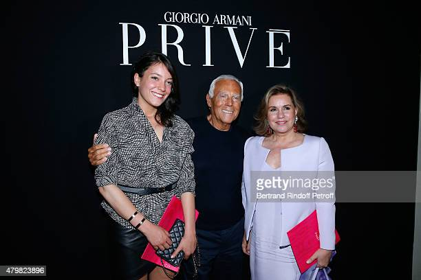 Giorgio Armani pose Backstage between Grand Duchess Maria Teresa de Luxembourg and her daughter Princess Alexandra de Luxembourg after the Giorgio...