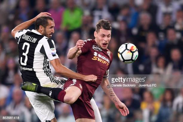 Giorgio Chiellini and Andrea Belotti during the Serie A match between Juventus and Torino FC on September 23 2017 in Turin Italy