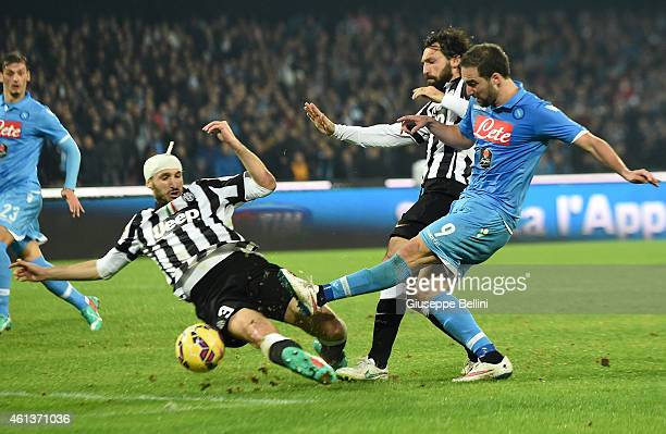 Giorgio Chiellini and Andrea Pirlo of Juventus and Gonzalo Higuain of Napoli in action during the Serie A match between SSC Napoli and Juventus FC at...