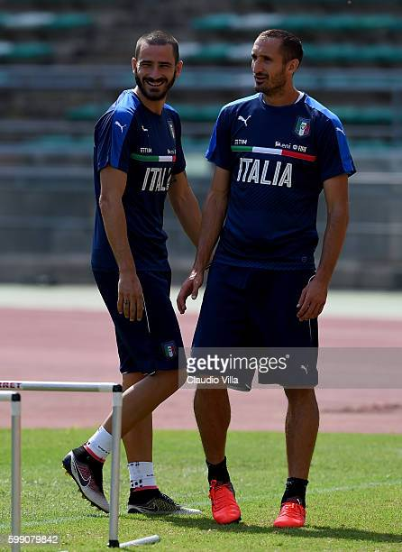 Giorgio Chiellini and Leonardo Bonucci chat during the Italy training session at Stadio San Nicola on September 4 2016 in Bari Italy