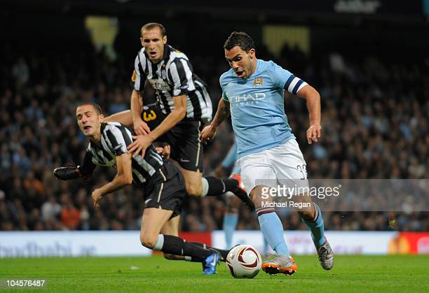 Giorgio Chiellini and Leonardo Bonucci of Juventus collide as they try to challenge Carlos Tevez of Manchester City during the UEFA Europa League...