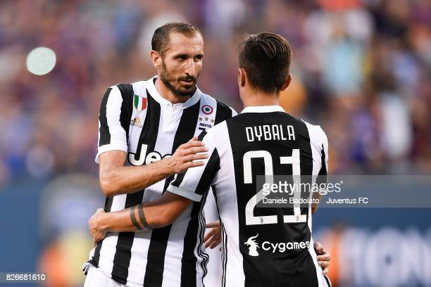 Giorgio Chiellini and Paulo Dybala of Juventus in action during the International Champions Cup match between Juventus and Barcelona at MetLife...
