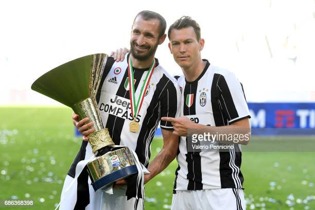 Giorgio Chiellini and Stephan Lichtsteiner of Juventus FC celebrate with the trophy after the beating FC Crotone 30 to win the Serie A Championships...