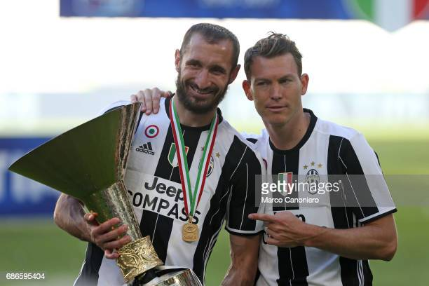 Giorgio Chiellini and Stephan Lichtsteiner of Juventus FC celebrate the victory of Italian Serie A after the match between Juventus Fc and Fc Crotone