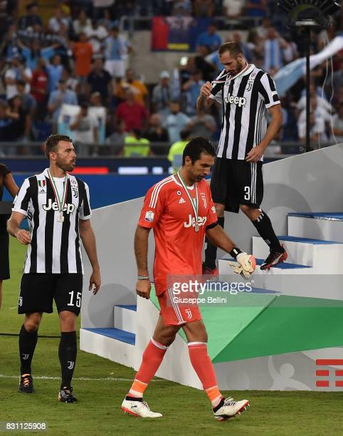 Giorgio Chiellini Andrea Barzagli and Gianluigi Buffon of Juventus after the Italian Supercup match between Juventus and SS Lazio at Stadio Olimpico...