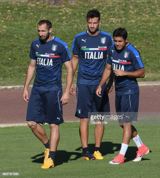 Giorgio Chiellini Gian Marco Ferrari and Eder of Italy look on during the training session at Coverciano on June 08 2017 in Florence Italy