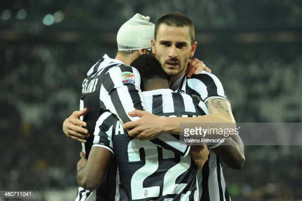 Giorgio Chiellini Kwadwo Asamoah and Leonardo Bonucci of Juventus celebrate victory at the end of the serie A match between Juventus and Parma FC at...