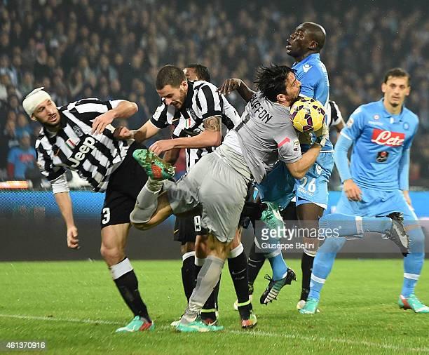 Giorgio Chiellini Leonardo Bonucci Gianluigi Buffon of Juventus and Kalidou Koulibaly of Napoli in action during the Serie A match between SSC Napoli...
