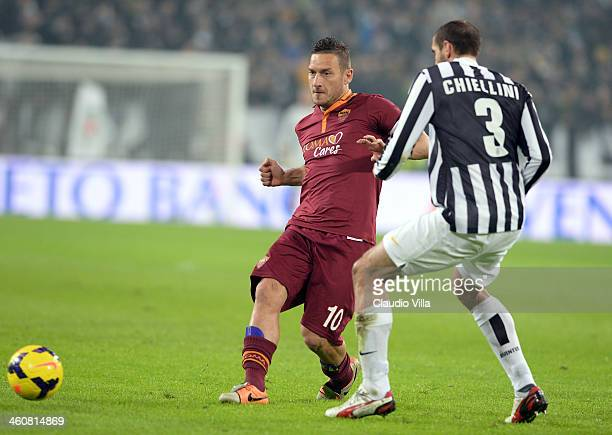 Giorgio Chiellini of FC Juventus and Francesco Totti of AS Roma compete for the ball during the Serie A match between Juventus and AS Roma at...